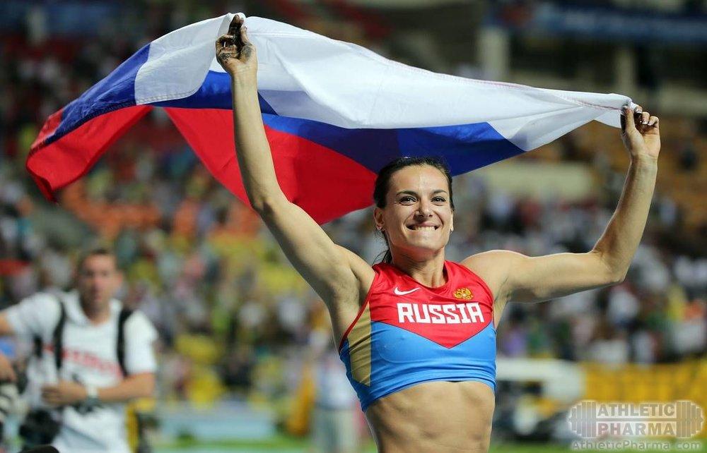 Легкоатлетка Исембаева с российским флагом